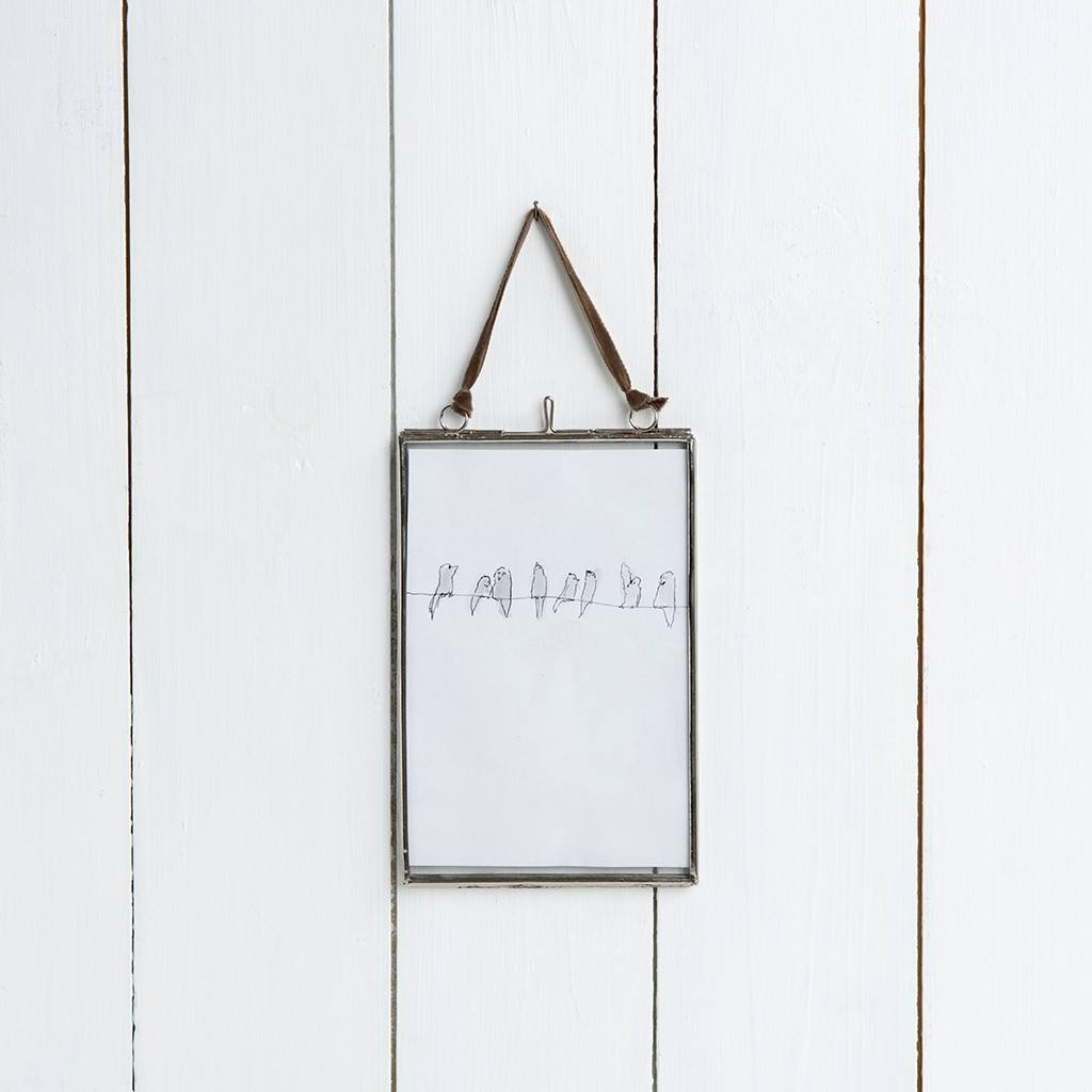 small glass hanging frame in silver